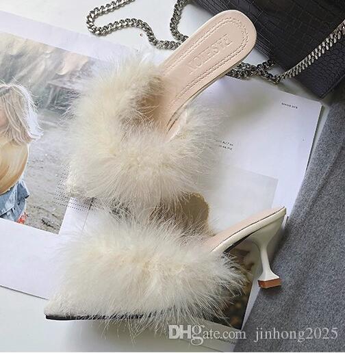 Nueva versión coreana de la primavera de las zapatillas peludas de punta salvaje que llevan la palabra baotou stiletto arrastre palabra de tacón