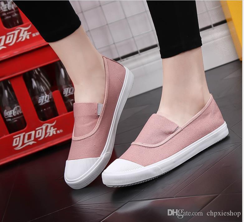Otoño nuevos zapatos de lona femenina de fondo plano con un pie bajo para ayudar a los zapatos casuales