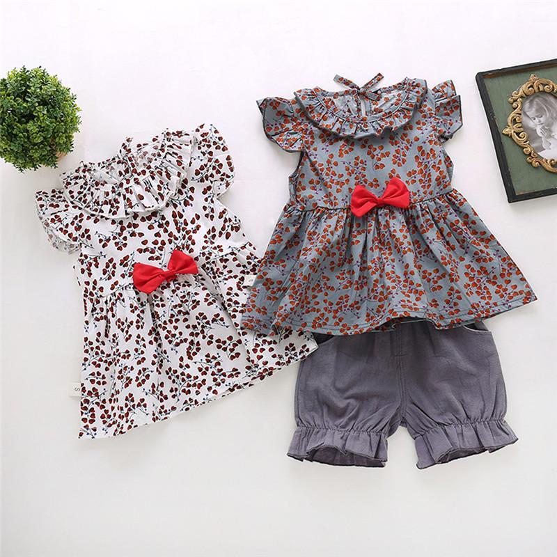 El más nuevo verano del bebé recién nacido ropa de la impresión floral del Bowknot T tapas de la camisa conjuntos de shorts 2pcs de la ropa del bebé Trajes
