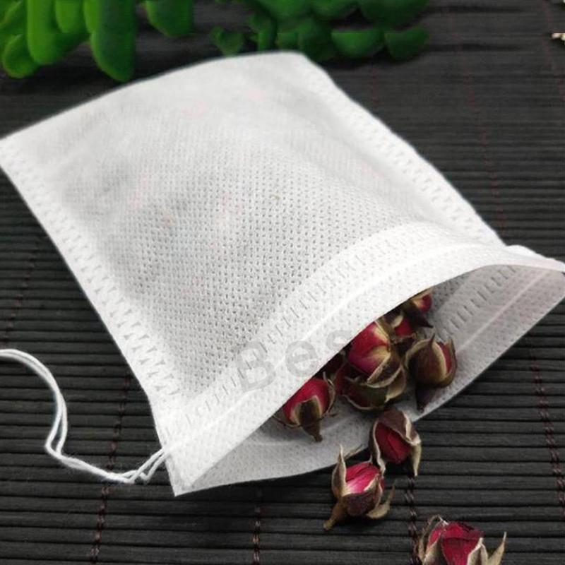 100Pcs / lot 60x80mm Tè non tessuto con coulisse Svuotare profumata Bustine di tè Heal guarnizione del filtro sacchetto per Herb allentati Foglie di tè Colino del DBC BH2725