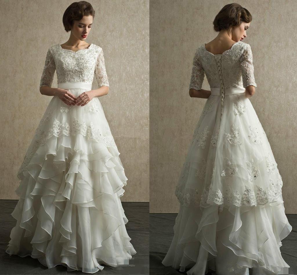 Mezze maniche Vintage Abiti da sposa scollo a rilievo Appliqued Tiered Organza Piano Lunghezza paese Beach Wedding Gowns Lace Up