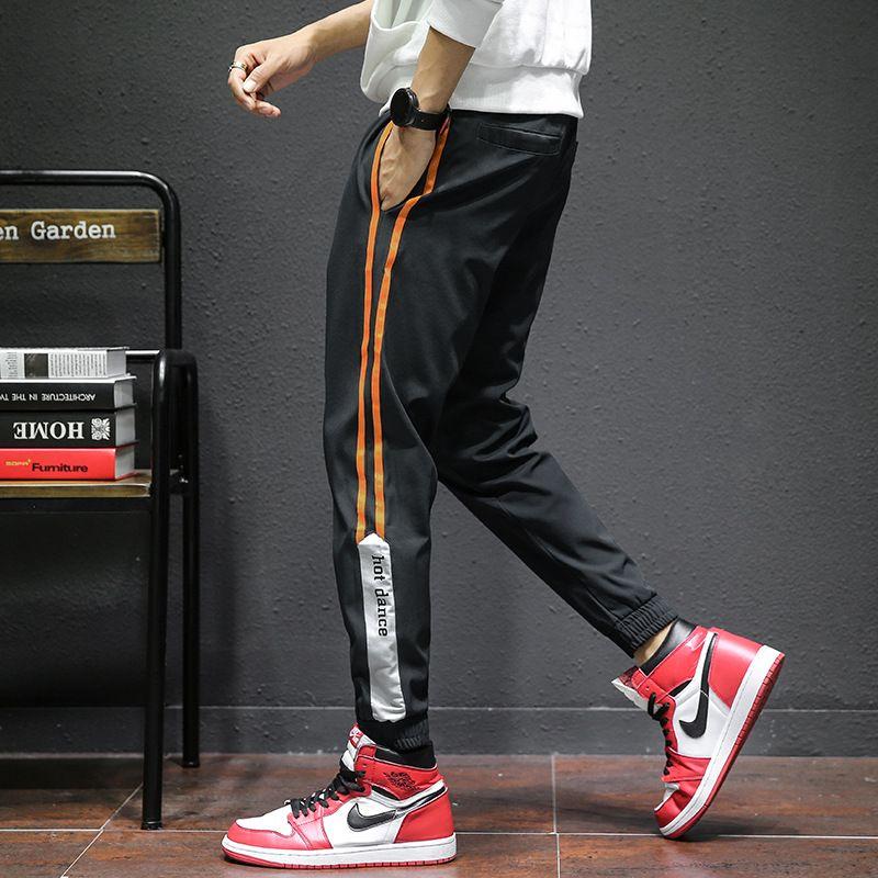 Uomini di marca Jogging Hip Hop Pantaloni sportivi giallo a strisce laterali pantaloni a righe Uomini cotone sudore Pant tasca tattica Streetwear Harajuku