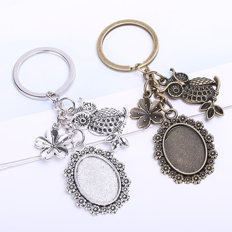 Catene Vintage chiave di metallo 18 * 25mm ovale Cabochon gioielli fai da Fare 5pieces Fiore gufo portachiavi per le donne / Lot