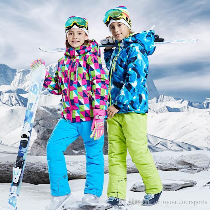 2020 caliente de la venta de la marca Niños / Niñas esquí traje pantalón impermeables + chaqueta de esquí de los deportes de invierno espesado ropa de nieve de los niños de la chaqueta de la capa snowboard