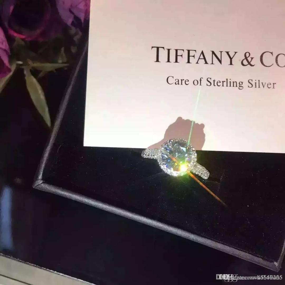 Nouvelles femmes bijoux 925 bague en diamant d'argent marque de luxe haut carbone quatre diamants forme Griffe Bague ronde Couple simple anneau boîte d'origine