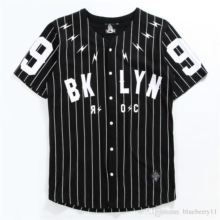 black and white baseball uniforms