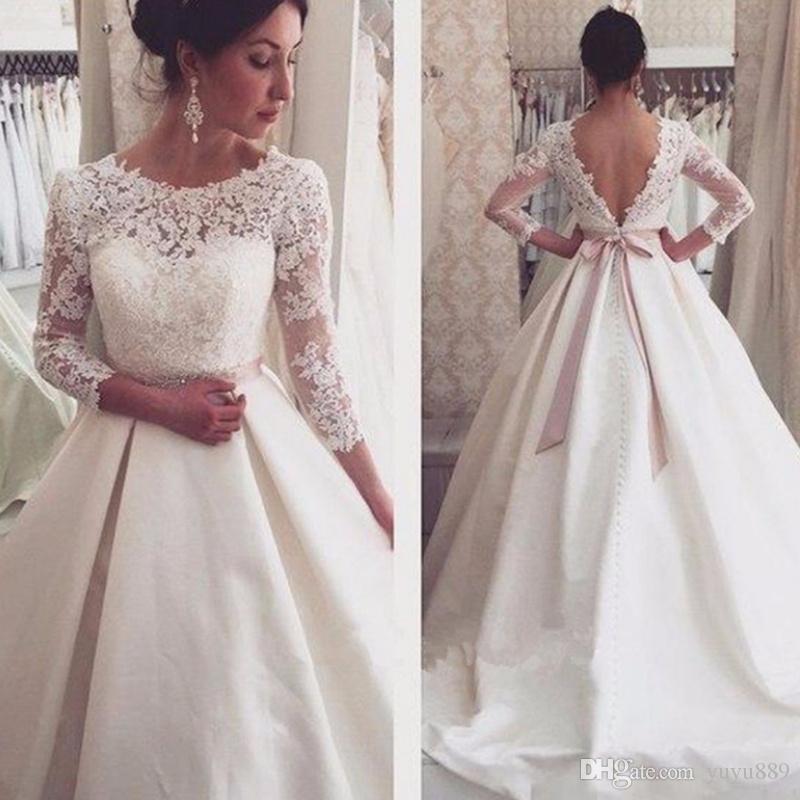 Nouveau Une ligne sweetheart femmes Robes de mariée perles longues Robes de mariée Appliques Blanc Tulle Abito Cerimonia robe de réception personnalisée