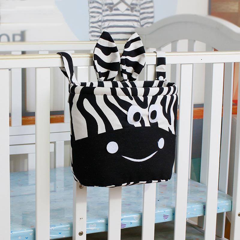 Cebra infantil de múltiples funciones de almacenamiento de la bolsa al bebé recién nacido del pesebre que cuelga pequeño bolso del pañal del bebé del pañal de bolsillo organizador juguete lecho