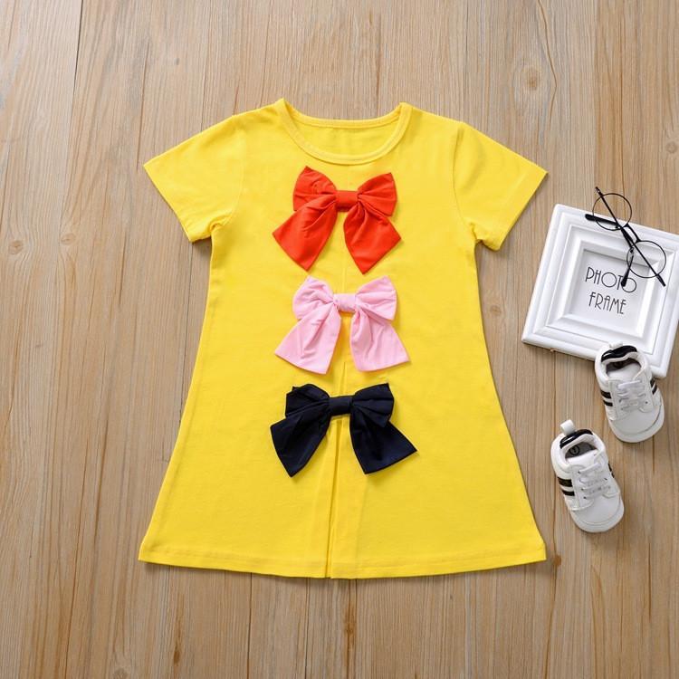 Niñas vestido de verano de manga corta camiseta larga de color caramelo T Shirts Niño bowknot falda linda de la muchacha vestido de la princesa de los niños Ropa de diseño CZ409