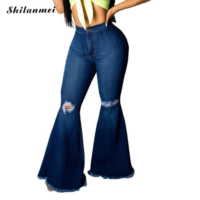 Mode Plus Taille Ripped Jeans pour les femmes Vintage Flare Denim Jeans Femme Pantalon large Pantalon évasé Femme Streetwear Denim