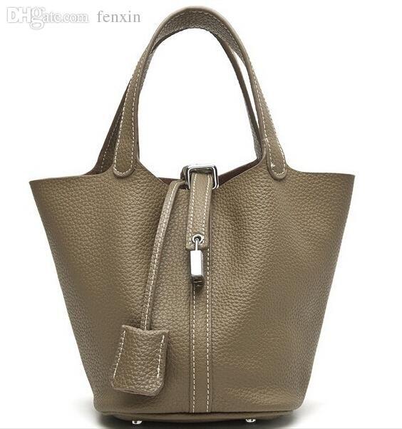Cuir véritable le plus vendu en gros 100% garantie sacs de verrouillage dame de la marque peau de vache femmes gratuit Envoi sacs seau sac à main femme