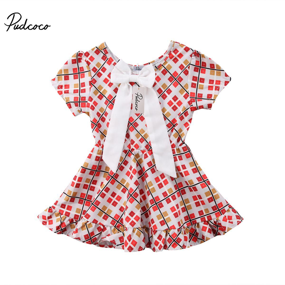 Schöner Kind-Baby-Mädchen-Bogen-Knoten-Kleid-Blumendruck Sommer Hübsche Sommerkleid-Partei-Festzug Tutu-Kleid stilvolle heißen Verkaufs Kleidung Neue