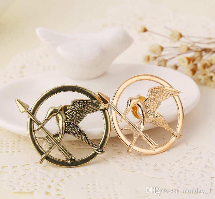 The Hunger Games Brooches Inspired Mockingjay And Arrow Brooches Pin Corsage Gold Bronze Silver free shipping