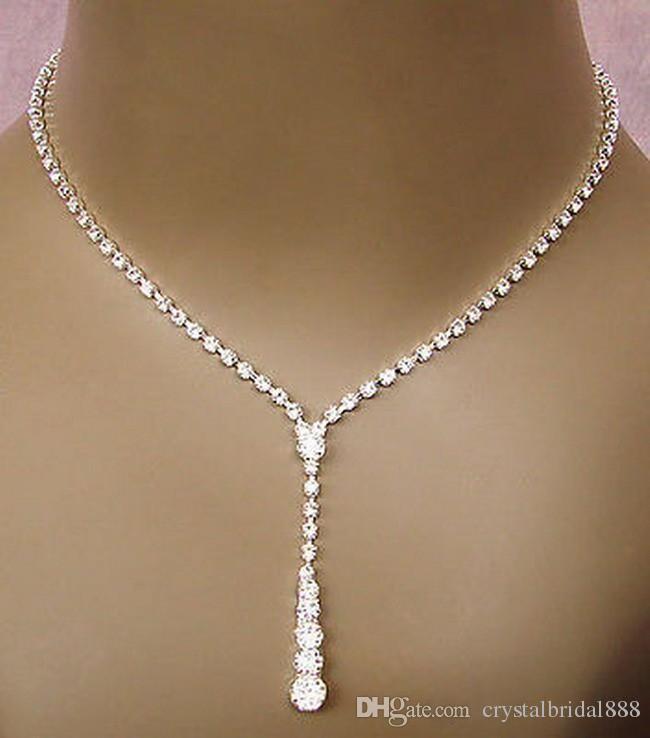 2019 Bling Crystal Bridal Ювелирные Изделия Серебристые Ожерелье Алмазные Серьги Свадебные Ювелирные Изделия Наборы для Невесты Неведимые Женщины Аксессуары