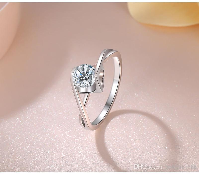 Mme argent sterling forage de simulation de platine plaquée incrustation en forme de coeur transparent zircon anneau d'enclenchement de mariage ornements boule