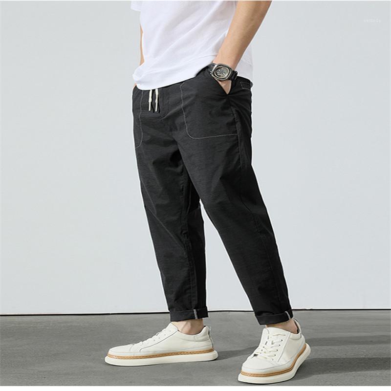 포켓 바지 패션 졸라 매는 끈 일반 바지 순수한 색 중간 연필 바지 남성 의류 남성 디자이너를 망