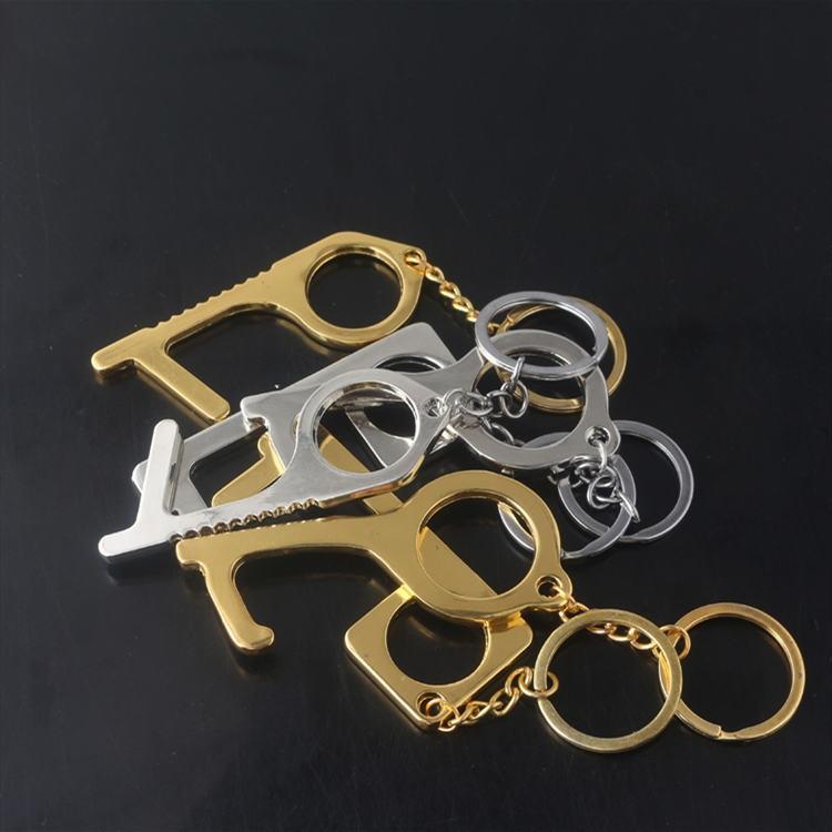 El nuevo metal de seguridad sin contacto Abridor de puerta de aguja Llave gancho de metal Manos puerta de mangos de herramientas abridor Ascensor Llavero T2I5965