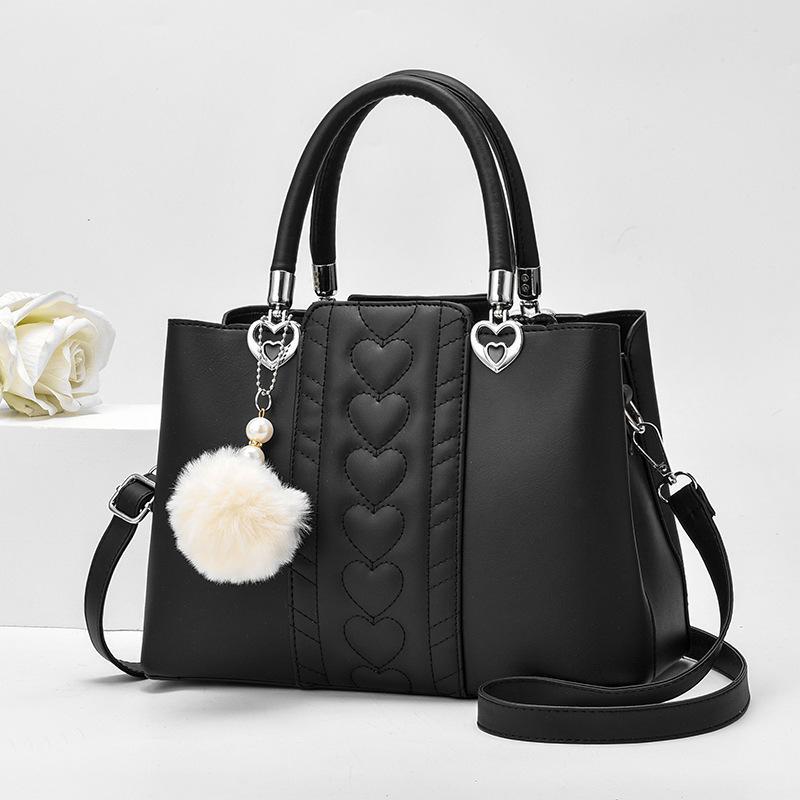 Corazón retro del modelo de Bolsas para mujeres 2020 bolsos de cuero PU Mujer con bolsa de bola de pelo Sac principal Femme señora ocasional del hombro