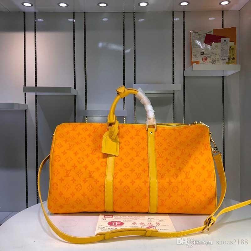 Mulheres e homens de grande capacidade de luxo bolsa tendência da moda limitada nova alta qualidade B7 mundial saco de viagem mala carteira M44645-3333