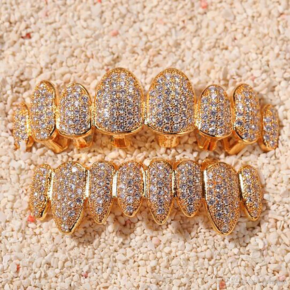 14k Oro CZ Vampire Dientes Grillz Iced Out Micro Pave Cubic Zircon 8 Dientes Hip Hop Parrilla Parte superior de la parte superior de los dientes Grillz Conjunto con la barra de moldeo de silicona