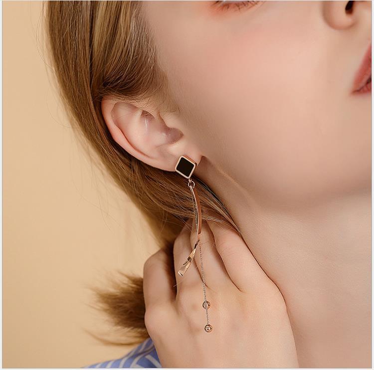 frange la personnalité de la mode shell carré noir Boucles d'oreilles style long élégant arc
