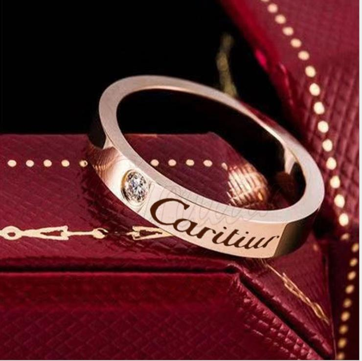 anillo de acero de titanio para los hombres y las mujeres anillo de pareja de acero inoxidable de Japón y Corea del Sur joyas de oro rosa