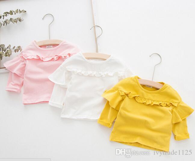 Ins Korea Girl Детская одежда рубашка с круглым воротом с длинным рукавом сплошной цвет оборками дизайн рубашка весна девушка мягкая 100% хлопок рубашка