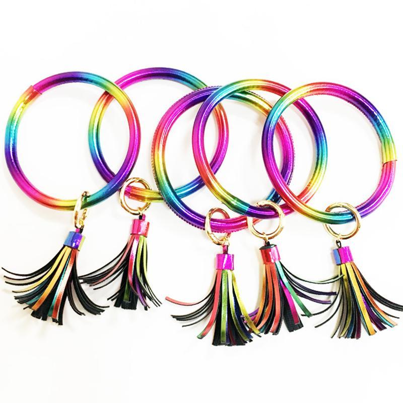 Círculo colorido redondo de cuero pulseras de los brazaletes de las mujeres de chicas Llaveros encantos de la cadena de joyería pulseras anillo de la mano de la borla del arco iris Llavero Moda