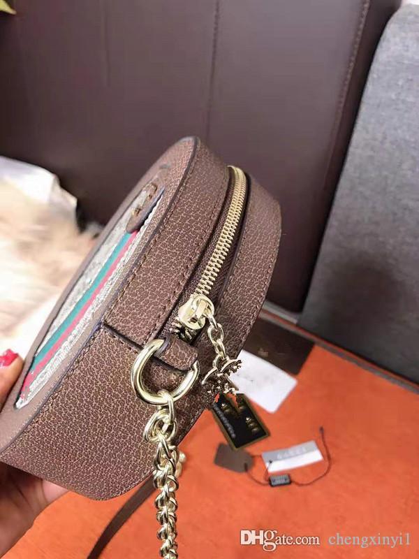 حقيبة يميل جولة حقيبة جلدية حقيقية حقائب اليد حقائب الكتف جديد سلسلة الصغيرة الأزياء Baoyuan الخبز هان الطبعة جوكر A مصمم الكتف