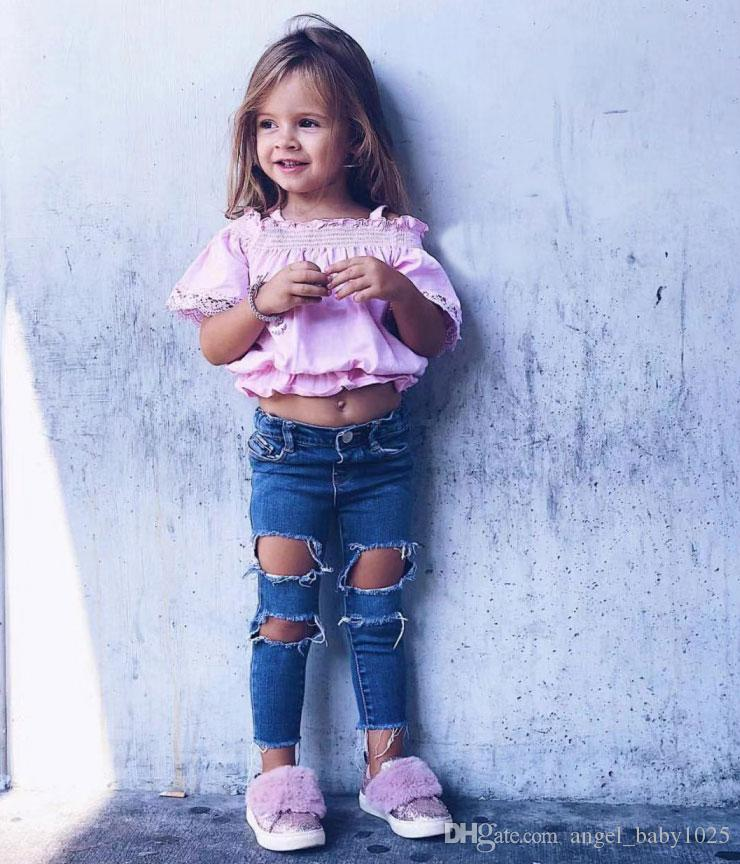 2019 novo roupas de criança de verão meninas europeus e americanos estilo laço cor de rosa oco de manga curta de um ombro camisa + buraco calça jeans terno