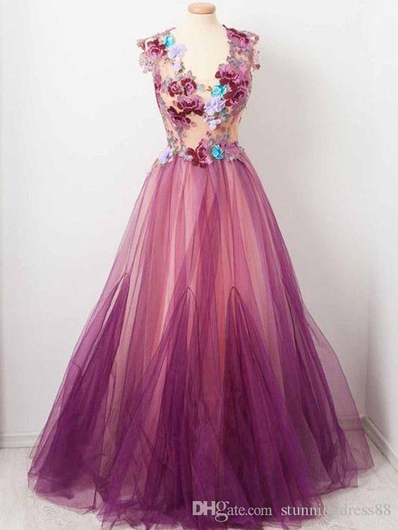 Sounth Flores estampadas africanas Cuello en V Vestidos de baile Mangas cortas Princesa Tul Hasta el suelo Bordado Vestido de quinceañera Vestido de famosos