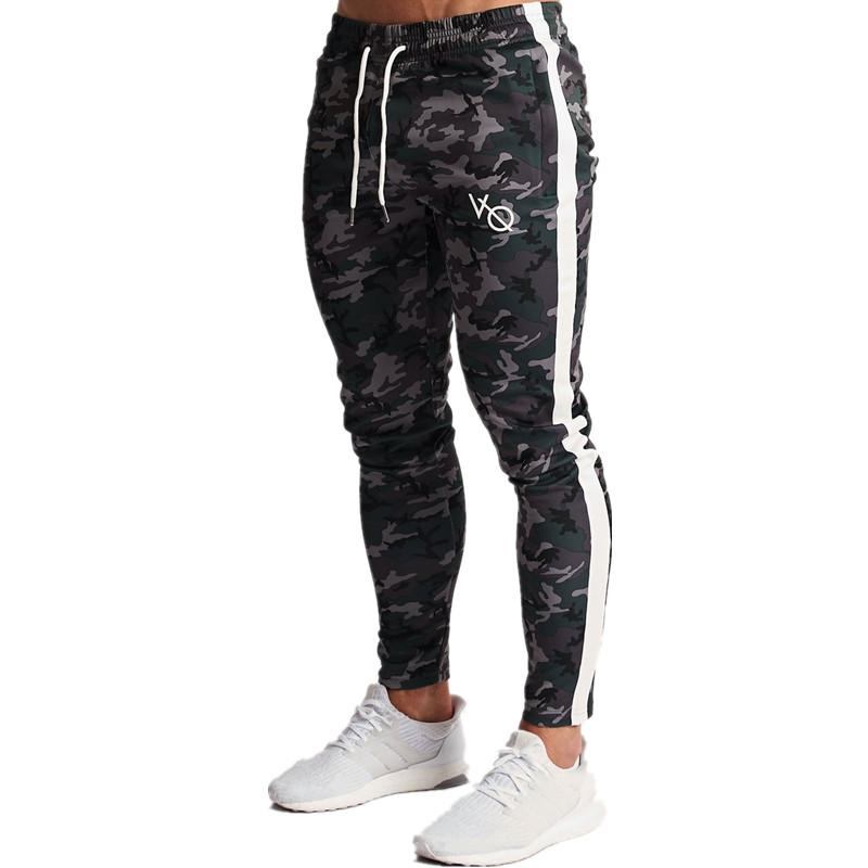YEMEKE Mens Joggers Casual Pants Fitness Men Sportswear Bottoms Skinny Sweatpants Trousers Fashion Gyms Jogger Track Pants