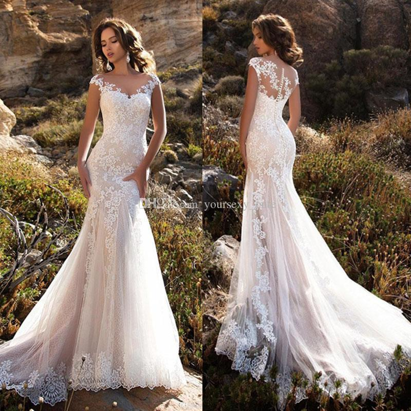 Sexy White Mermaid Wedding Dresses Sheer Neck Cap Sleeves Lace Appliques Tulle See Through Button Wedding Dresses Bridal Gowns Vestidos