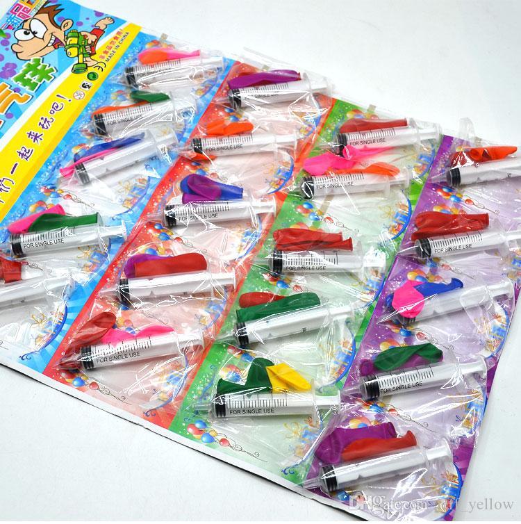 Juguete libre tablero del envío de los nuevos 20 jeringa pequeña de la promoción juega estudiante de escuela primaria niño globo pistola de agua de la compra colgando