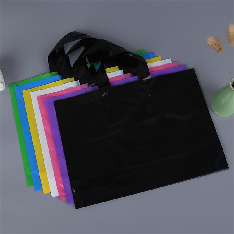 핸들 솔리드 컬러 의류 / 의류 / 선물 가방 파티 포장 플라스틱 쇼핑 가방 사용자 정의 로고 인쇄 사용 가능한 DHA165 공급