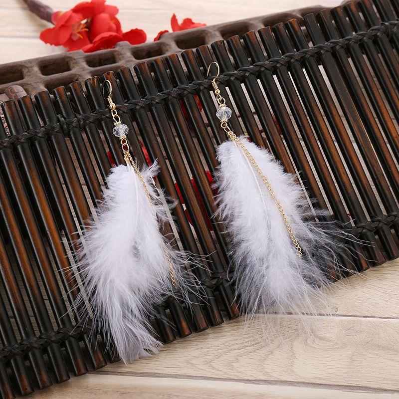 Nouveau super fées net boucles d'oreilles en plumes longues rouges féminins cristal créative coréenne boucles d'oreilles pompon irrégulière Boucles d'oreilles de mode