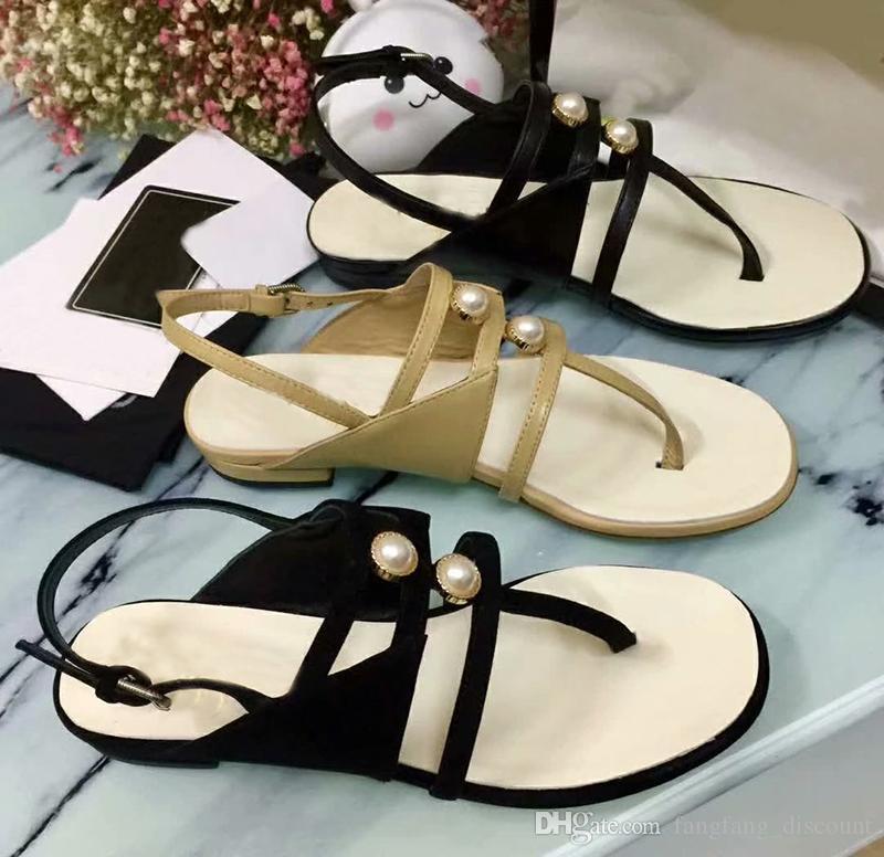 Nuevo verano pizca de sandalias romanas para mujer de fondo plano de perlas del dedo del pie bajo talón de moda de hebilla de cuero zapatos de mujer