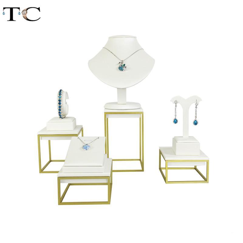 جودة طلاء الفولاذ المقاوم للصدأ القرط عرض مجوهرات قلادة معرض الأبيض PU مجوهرات عرض موقف
