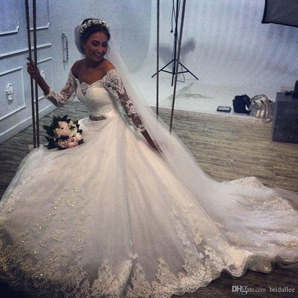 Robe de mariée à manches complètes sur mesure sur mesure avec dentelle perlée Applique Chapelle Train Bouton Dentelle Mère des robes de la mariée