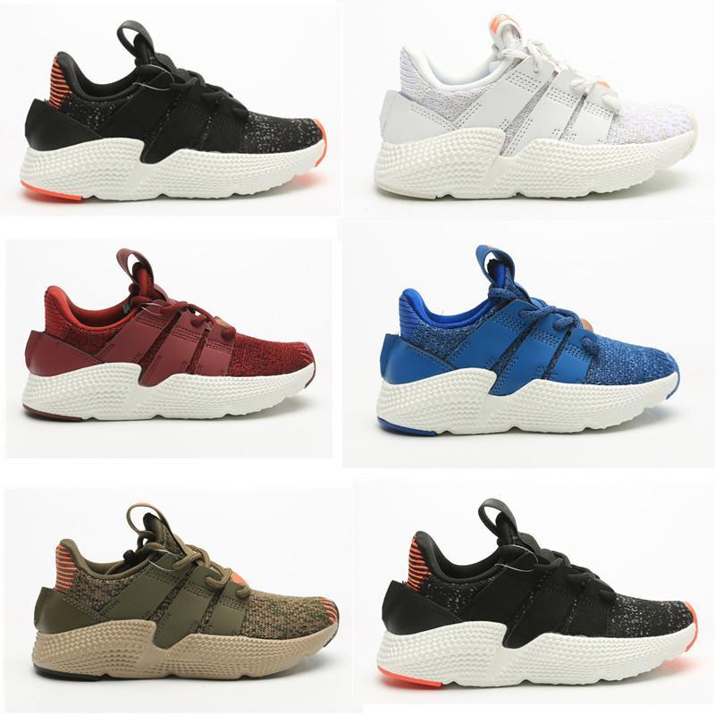 Niños infantiles Running Shoes Originales Profhere Sneakers Negro Azul Amarillo Rojo Rojo Niños Niños Niñas Junior Pupilas Entrenadores con caja