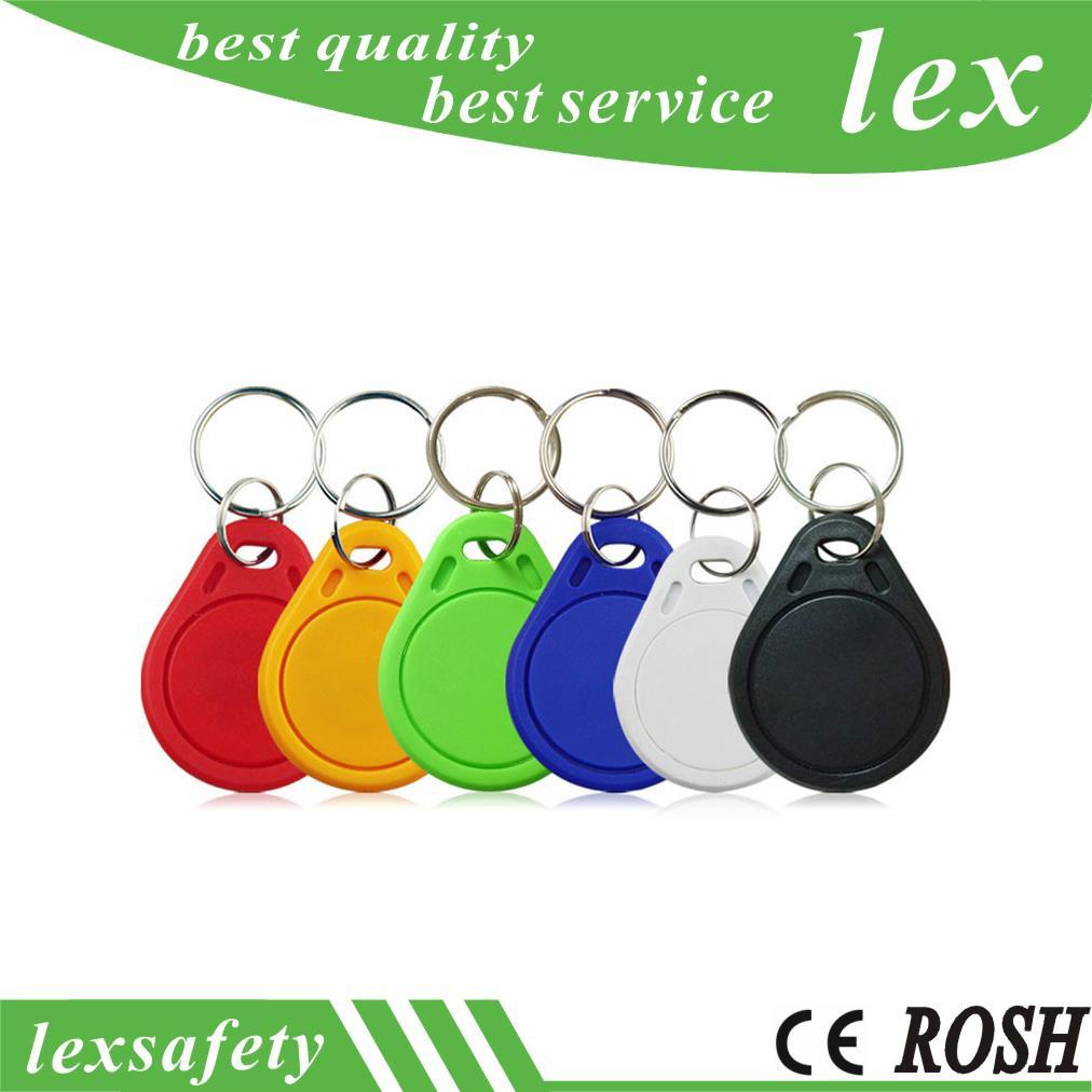 Les moins chers Prix usine de haute qualité EM4100 125kHz 100pcs / lot ISO11785 ABS RFID clé Fobs en plastique personnalisé Balises