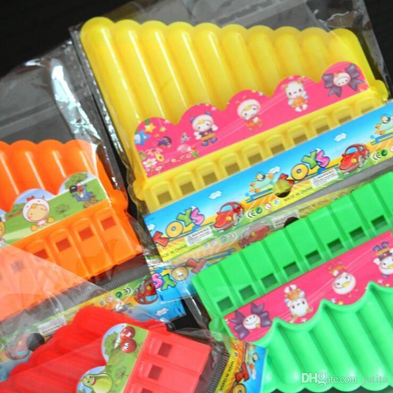 Dibujos Animados Color caramelo armónica niños Mini instrumentos musicales juguete ruido fabricante fiesta de cumpleaños Favor regalo