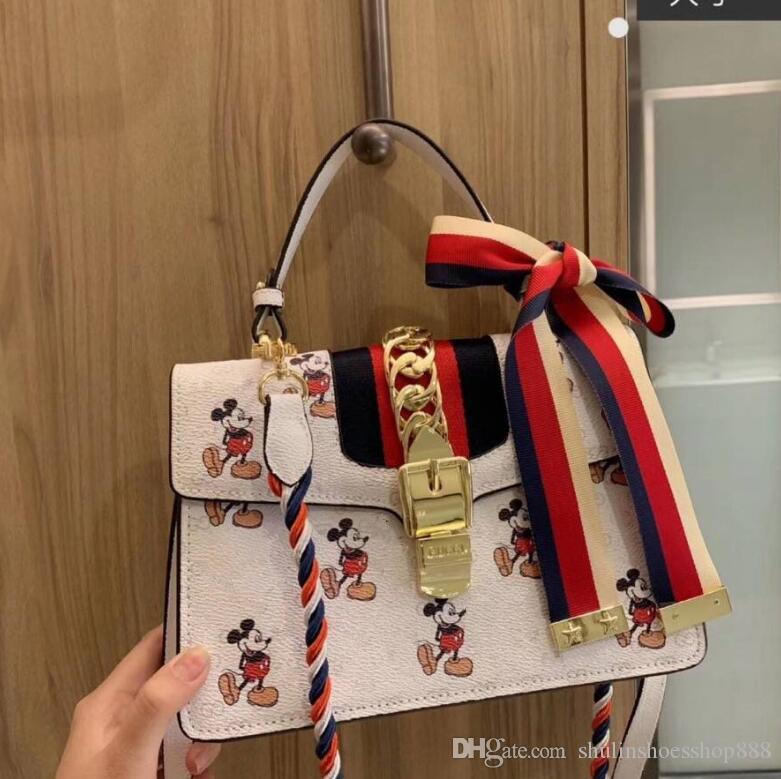 20SS 새로운 만화 체인 메신저 가방 어깨 가방 럭셔리 디자이너 핸드백 이탈리아 브랜드 여성의 어깨 가방 크로스 바디 레이디 토트 지갑