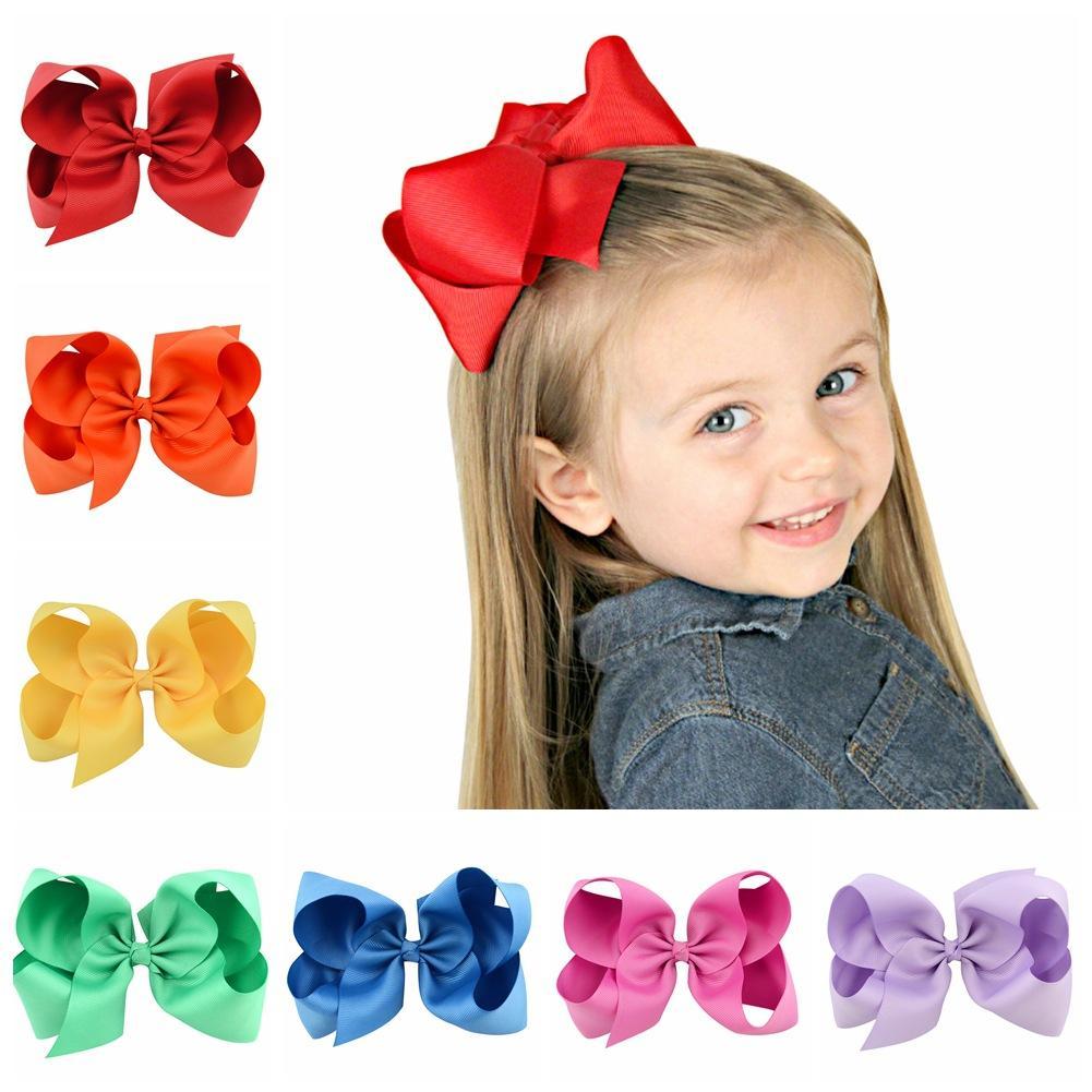 Los niños de 6 pulgadas horquilla arco sólidos clips de color Bowknot bebé de la cinta arco pasador de niños Headwear Boutique Accesorios GGA2679