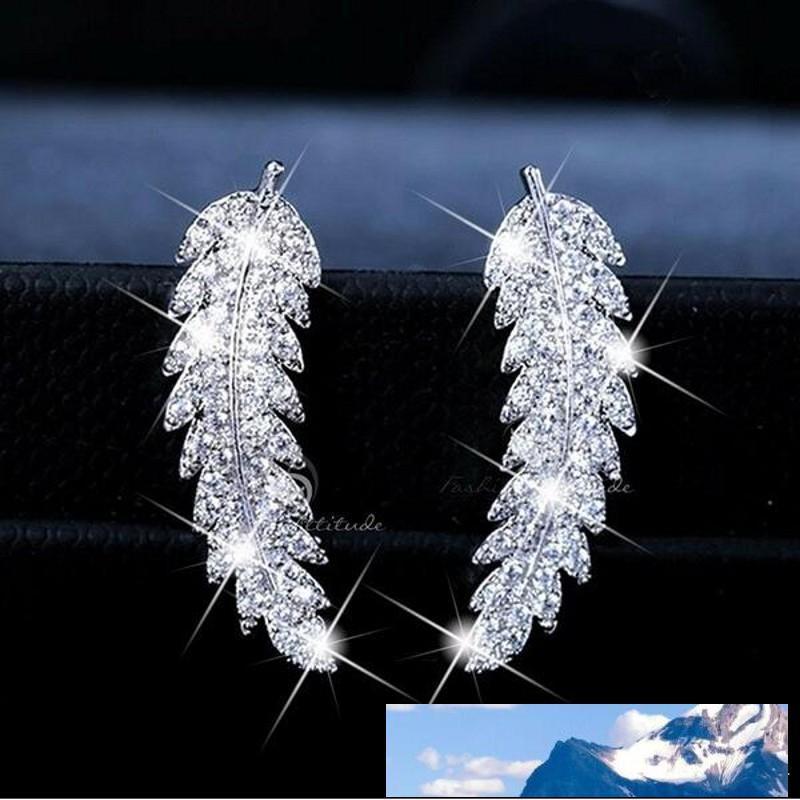 وصول ساخنة جديدة بيع المجوهرات 925 فضة مهد الأبيض الياقوت CZ الماس ليف الريشة مربط القرط للنساء Giift