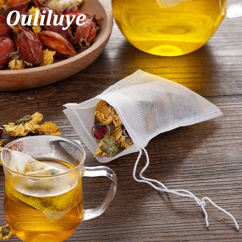 حزمة ساخنة جديدة 100pcs التي أكياس 5.5 × 7CM فارغة حقائب الشاي المعطر مع سلسلة شفاء ختم فلتر ورقة لعشب فضفاض الشاي شركة Bolsas