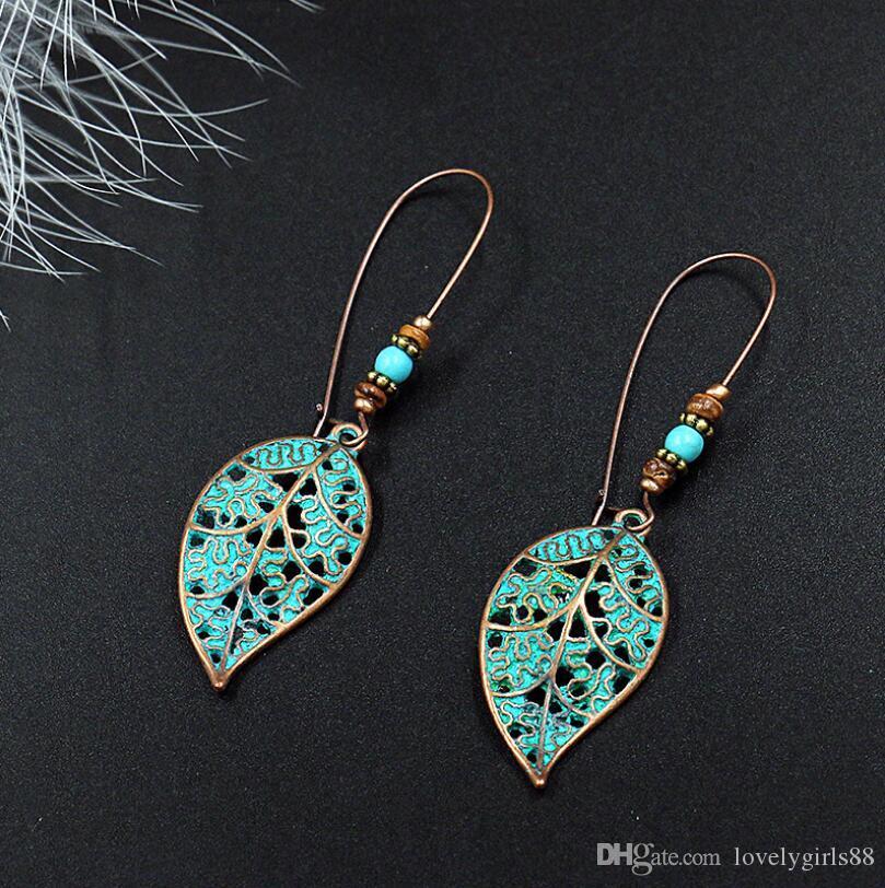 Gancho del oído de las mujeres regalos de joyas retro hueco deja de lado la aleación del metal del pendiente pendiente de bronce de cobre secuencia del grano de la turquesa de la hoja del encanto de largo gota para el oído