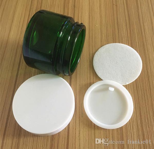Frasco de crema cosmética de vidrio de 50 g. Contenedor de cera de 50 ml. Recipiente de almacenamiento de color verde con tapa blanca y negra plateada. Producto caliente.
