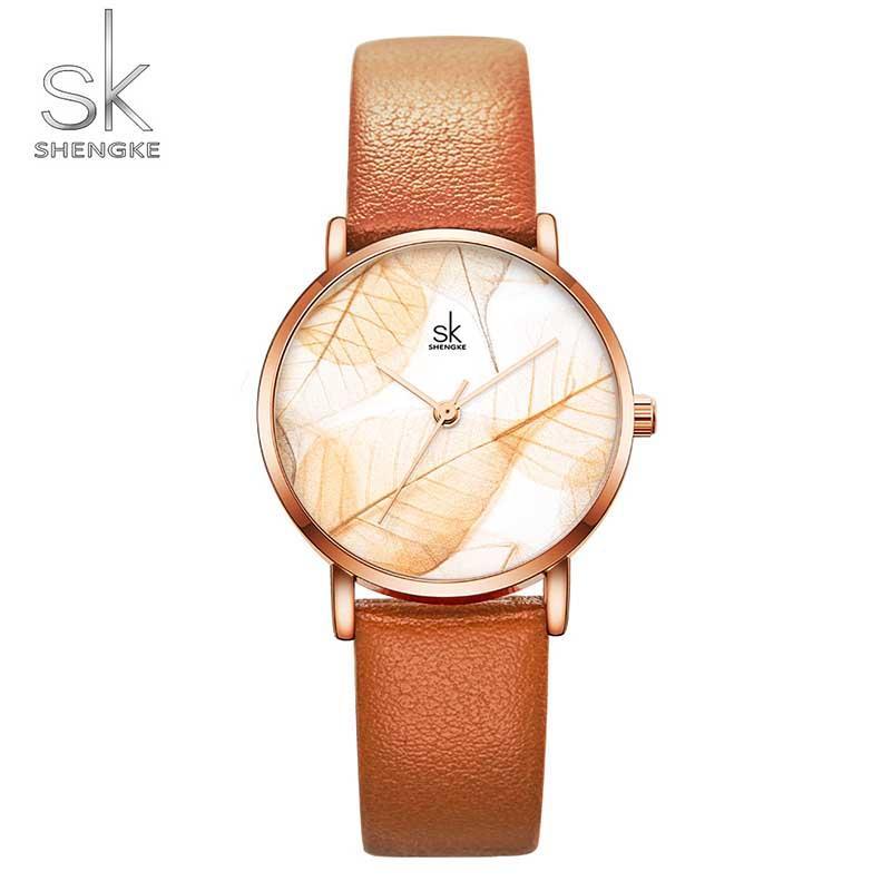 Shengke Kadınlar Saatler SK Ladies Yaratıcı Deri Kayış Quartz Saat Moda Günlük Kadın Kol Saatleri Hediye