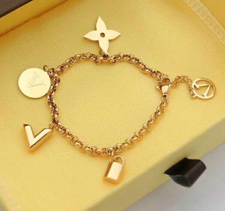 Nuevo diseño de moda carta de bloqueo accesorios pulsera de la flor de la marca redonda en forma de V para las mujeres pulsera de regalo